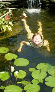 Girl swimming in pond